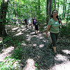 Jonathan Tressler - The News-Herald. Holden Arboretum guide Eva Stephans leads a group of visitors through the middle portion of the trail to the top of Little Mountain on a June 11 family hike.