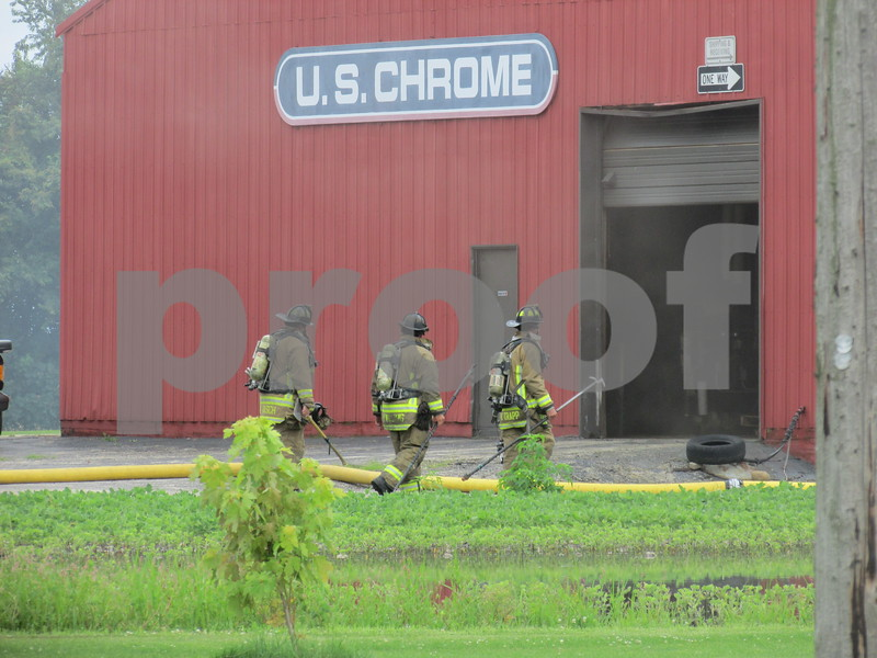 Firefighters work the scene Monday afternoon at U.S. Chrome Corp. of Illinois, 305 Herbert Road, where it took about an hour to put out a fire at the chrome plating plant. No injuries were reported.