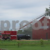 Firefighters finish getting a fire under control while smoke dissipates Monday afternoon at U.S. Chrome Corp. of Illinois, 305 Herbert Road, Kingston, where it took about an hour to put out the blaze. No injuries were reported.