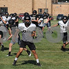 Sycamore High School football players run drills during  a mini camp workout on Wednesday, July 11.<br /> Steve Bittinger - For Shaw Media