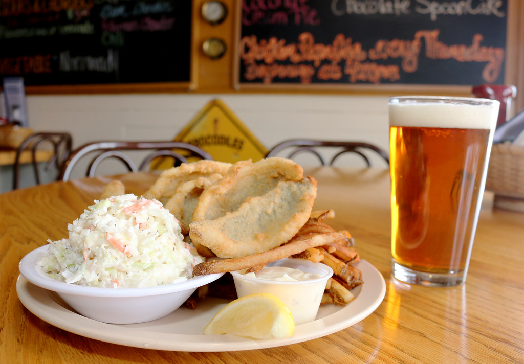 . Jonathan Tressler � The News-Herald <br> The perch dinner at Brennan\'s Fish House, pictured here next to a pint of New Belgium Brewing\'s Fat Tire Amber Ale, is a beloved dish among many of the restaurant\'s patrons.