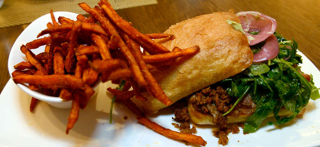 . News-Herald file <br> The Adega is a signature sandwich made with ground chorizo, serrano, tomato, cilantro, arugula, pickled red onion manchego and basil pesto aioli and served with sweet potato fries.