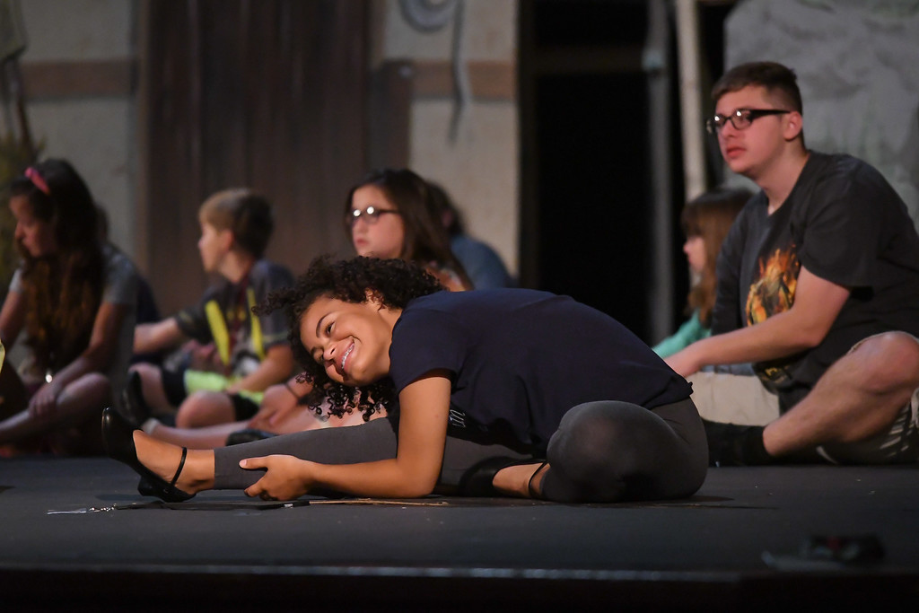 """. Eric Bonzar � The Morning Journal <br> Seventeen-year-old Ayanna Cash stretches before the start of rehearsal for the Lorain Palace Youth Theater\'s upcoming performance of \""""Shrek the Musical Jr.\"""" The group\'s 40th anniversary show is 7 p.m. July 21 and 22, and 2 p.m. July 23 at Lorain Palace Theater at 617 Broadway Ave. in Lorain. General admission tickets cost $10 at the door or online at www.lorainpalace.org."""