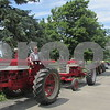 Monte Smith waits to drive Orville Olson's 1963 tractor as part of the procession to Olson's burial site in Elmwood Cemetery. Olson's daughter, Andra Olson, came up with the idea for the tractor escort. She said she wanted to do something different at the service but wanted make sure it was something that he loved and reflected who he was. Orville Olson was a lifelong farmer and lived his whole life in Cortland.