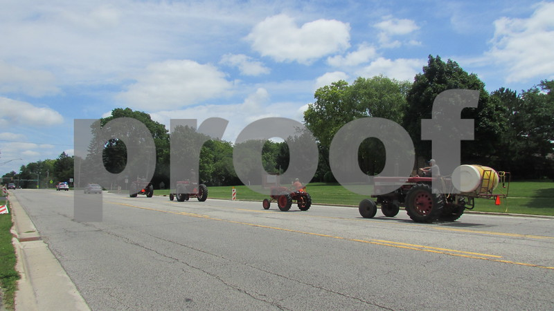 Tractors form a procession to escort lifelong Cortland farmer Orville Olson to his burial site in Elmwood Cemetery. Olson was 100 years old when he died July 9.