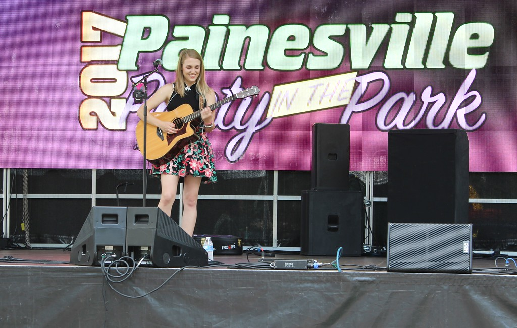 . Tawana Roberts � The News-Herald <br> Erin Burke performs at Painesville Party in the Park , July 14, 2017.