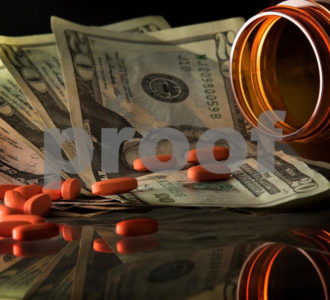 dnews_0714_Prescript_Costs_COVER