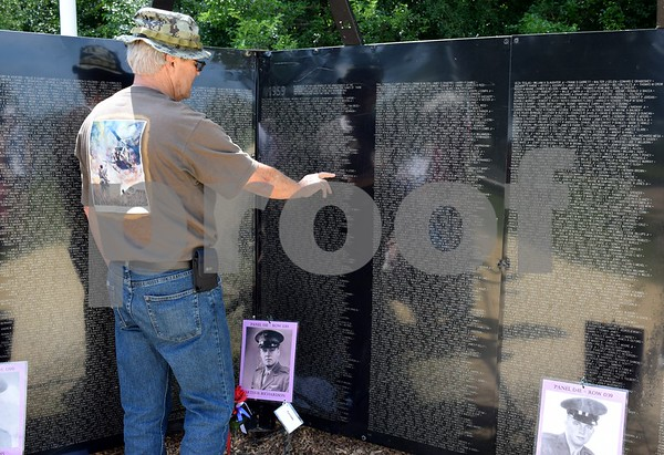"Guy Sparrow of Kirkland visited the Wall that Heals in Sycamore Community Park on Saturday, July 15, to locate the names of Vietnam War soldiers he knew that lost their lives during the war. In this photo, Sparrow located the name of Arthur ""Bud"" Richardson, a family friend and schoolmate. Richardson, a helicopter pilot, was the second soldier from Illinois to be killed during the Vietnam War."