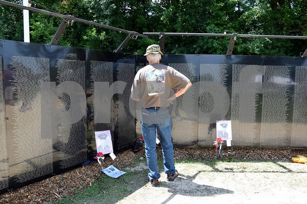 Guy Sparrow of Kirkland visited the Wall that Heals in Sycamore Community Park on Saturday, July 15, to locate the names of Vietnam War soldiers he knew that lost their lives during the war. The wall visited Sycamore July 13 to 16.