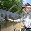 Erv Brauer of Montgomery visited the Wall that Heals in Sycamore Community Park on Saturday, July 15, to locate the names of Vietnam War soldiers he knew who lost their lives during the war. In this photo, Brauer located the name of Capt. Frederick Henderson, his company commander. Brauer, an Army veteran, received training under Henderson at Fort Knox. After basic training, Brauer had two weeks vacation. During that time, Henderson was sent to Vietnam and was killed during his service.