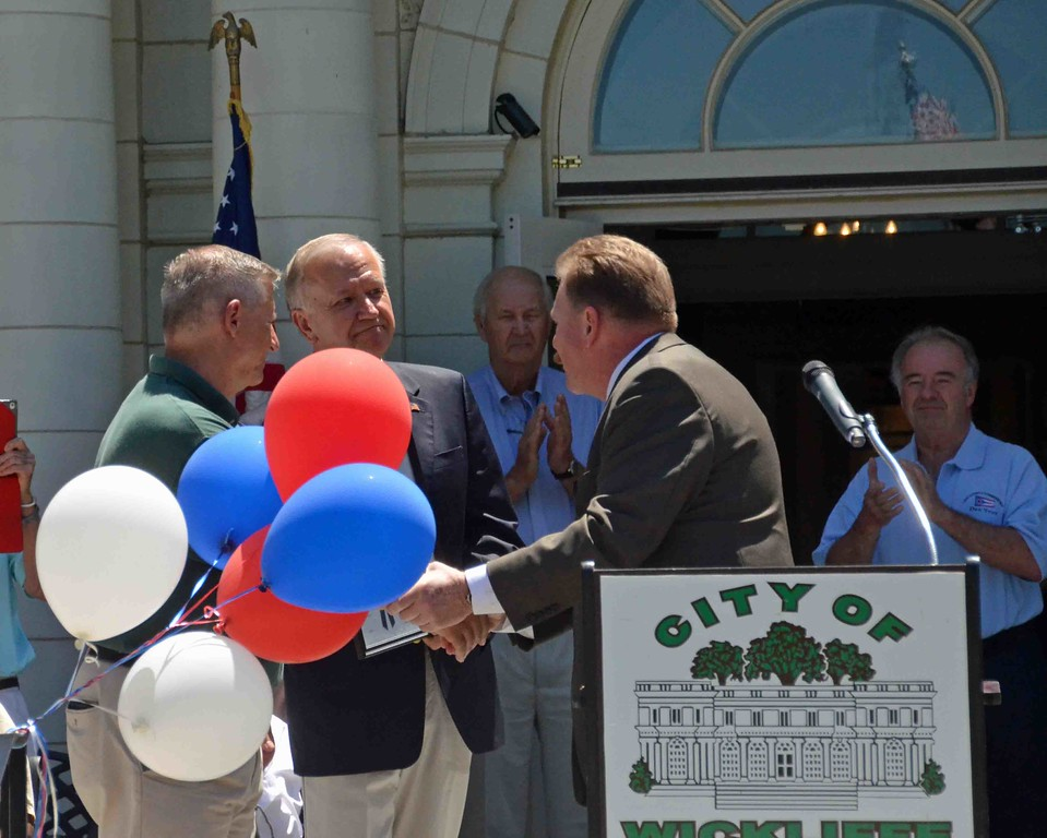 . Paul DiCicco � The News-Herald <br> Ohio Representative John Rodgers presents a proclamation from the state House of Representatives to Mayor Margalis and Council President Dave Krych.