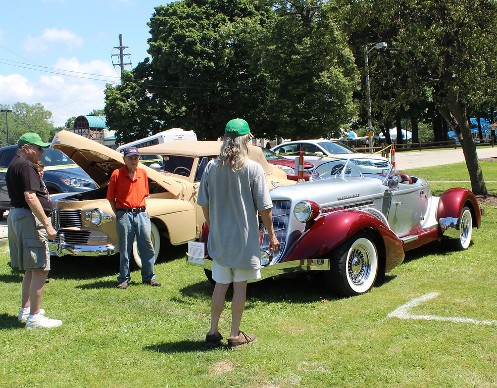 . Tawana Roberts � The News-Herald <br> Visitors enjoy the antique car show on July 15 at the Wickliffe Bicentennial celebration.