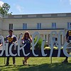 "Paul DiCicco — The News-Herald <br> Some members of ""Wickliffe Forever."" From left, Vince Laurie, Dominic Laurie, Marcia and Matt Kish.  Marcia created this sign for photo-ops during the bicentennial celebration."