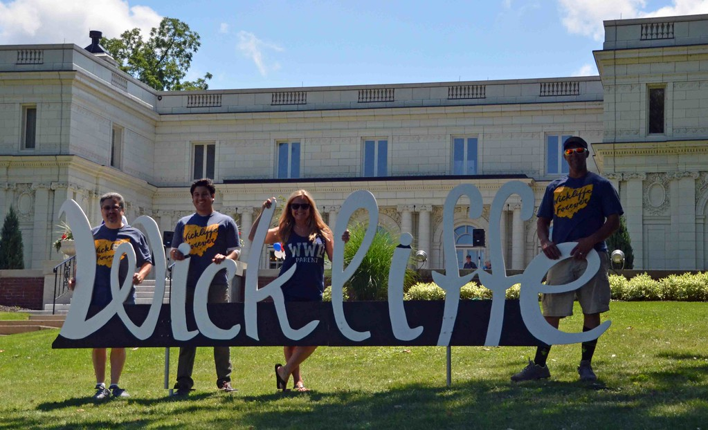 . Paul DiCicco � The News-Herald <br> Some members of �Wickliffe Forever.� From left, Vince Laurie, Dominic Laurie, Marcia and Matt Kish.  Marcia created this sign for photo-ops during the bicentennial celebration.