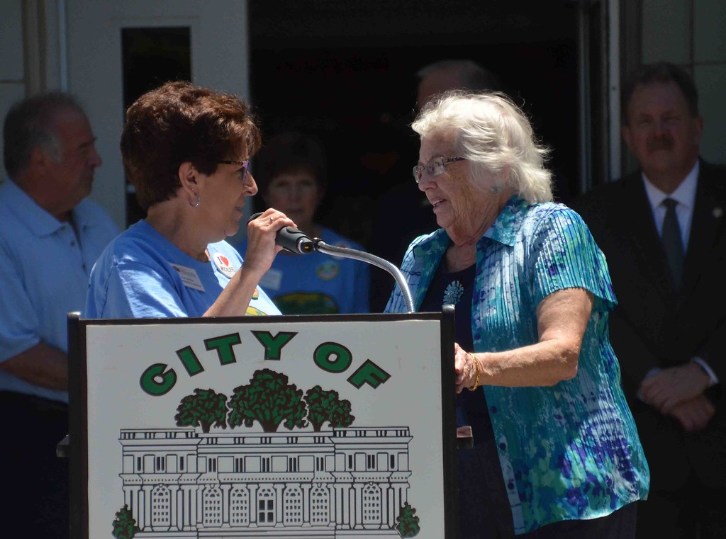 . Paul DiCicco � The News-Herald <br> Mayor�s secretary, Sue Iafalice, introduces members of the Coulby family.