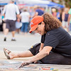 Carrie Garland — The News-Herald <br> Lori Kavanaugh Lewarski created a design using chalk at the 2017 Willoughby ArtsFest on July 15, 2017.