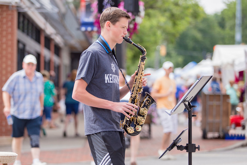 Carrie Garland — The News-Herald <br> Eric Sconyers, known as The Sax Slayer, entertained audiences at the 2017 Willoughby ArtsFest on July 15, 2017.