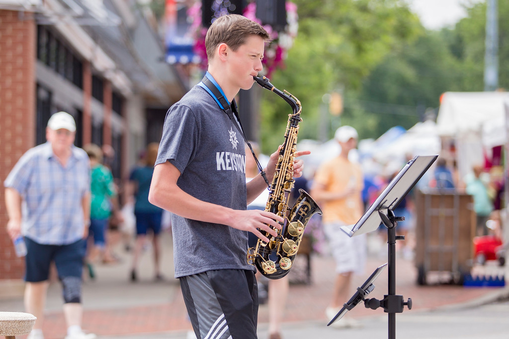 . Carrie Garland � The News-Herald <br> Eric Sconyers, known as The Sax Slayer, entertained audiences at the 2017 Willoughby ArtsFest on July 15, 2017.
