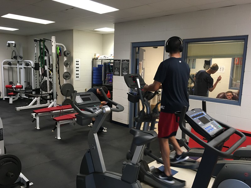 David S. Glasier - The News-Herald<br /> Home clubhouse weight room and fitness area, pitcher Justin Garza on step machine