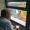 David S. Glasier - The News-Herald<br /> Official scorer Mike Mohner, press box, suite level