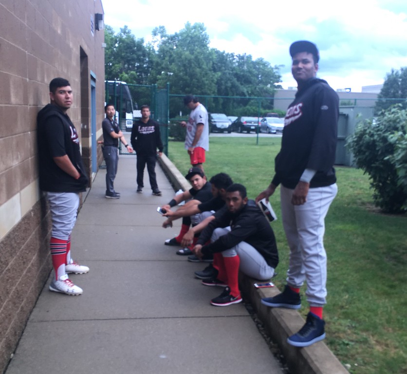 . David S. Glasier - The News-Herald Great Lakes Loons players during rain delay, outside visitors clubhouse