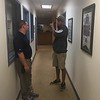 David S. Glasier - The News-Herald<br /> Captains general manager Neil Stein and head groundskeeper Christo Wallce confer during a rain delay in the executive offices.