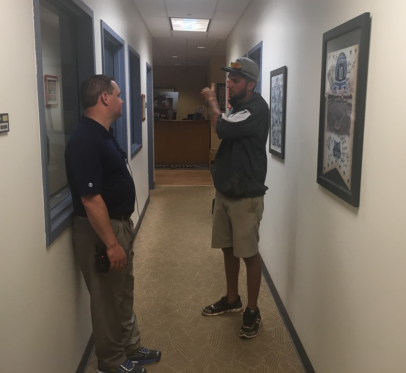 . David S. Glasier - The News-Herald Captains general manager Neil Stein and head groundskeeper Christo Wallce confer during a rain delay in the executive offices.