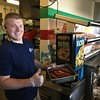 David S. Glasier - The News-Herald<br /> Concession stand worker Blaze Garnettcarrying a pan of hot dogs, a ballpark favorite.