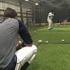 David S. Glasier - The News-Herald<br /> Batting practice, rain delay, Captains infielder Alexis Pantoja (back to camera).