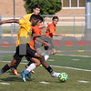Sam Buckner for Shaw Media.<br /> Matt Coulibaly tries to get past a DeKalb defender on Tuesday July 19, 2017.