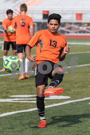 Sam Buckner for Shaw Media.<br /> Ricardo Sanchez kicks a ball during warmups before a scrimmage against Sycamore on Tuesday July 19, 2017.