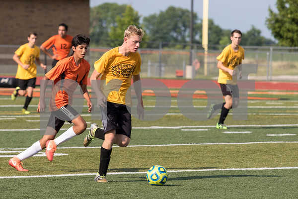 Sam Bcukner for Shaw Media.<br /> Matt Tronc dribbles the ball down the field on Tuesday July 19, 2017 during a scrimmage against Dekalb.
