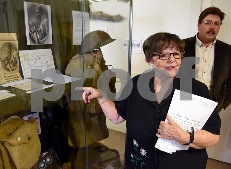 Carol Johnson of Sycamore, great niece of Marine Clinton Glidden looks over artifacts honoring Glidden during a program on Sunday at the Glidden Homestead and Historical Center.  Steve Bittinger - For Shaw Media