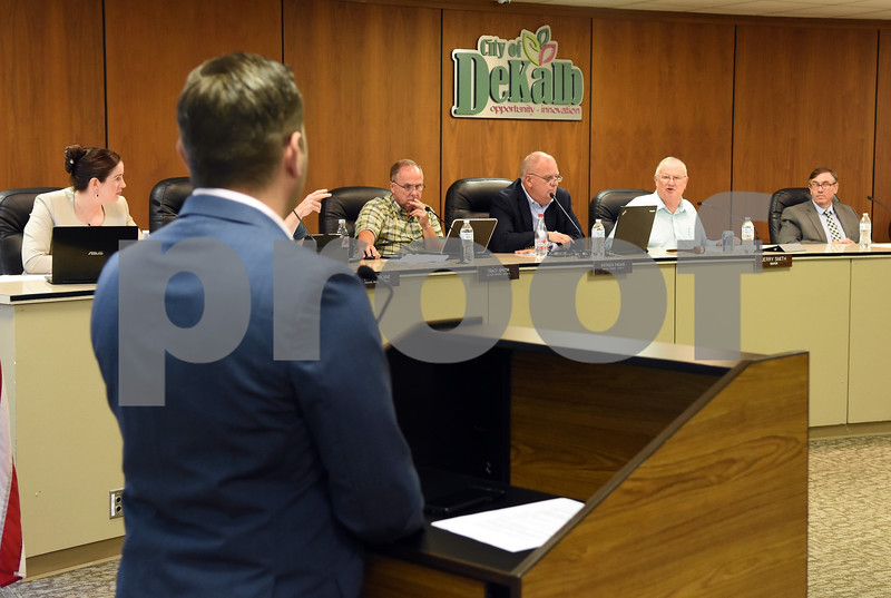 Mayor Jerry Smith questions Alulu Brewery CFO Derek Bly during the DeKalb City Council meeting on Monday.  Steve Bittinger - For Shaw Media