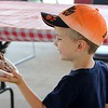 Colin Conway, 4, Meadeville, PA, gets a bowl of ice at Farmpark's Ice Cream Weekend July 23. (Kristi Garabrandt/The News-Herald.)