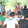 Patrons eat ice cream at the Lake Metro Parks Farmpark Ice Cream Weekend July 22-23.  (Kristi Garabrandt/The News-Herald.)