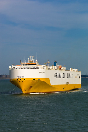 Commercial cargo ship arriving to Southampton, United Kingdom