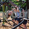 Maria Nihei of DeKalb helps her 1-year-old, Clark, climb on the playground equipment Saturday at newly renovated Lions Park, 700 W. Taylor St. in DeKalb. Lions Park's grand reopening celebration included a ribbon cutting and free refreshments.