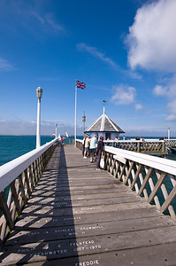 People strolling and relaxing on the pier, Yarmouth, Isle of Wight, United Kingdom