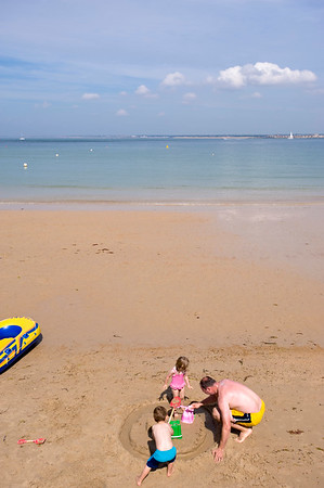 Families enjoy hot summer day on the beach in Colwell Bay, Isle of Wight, United Kingdom