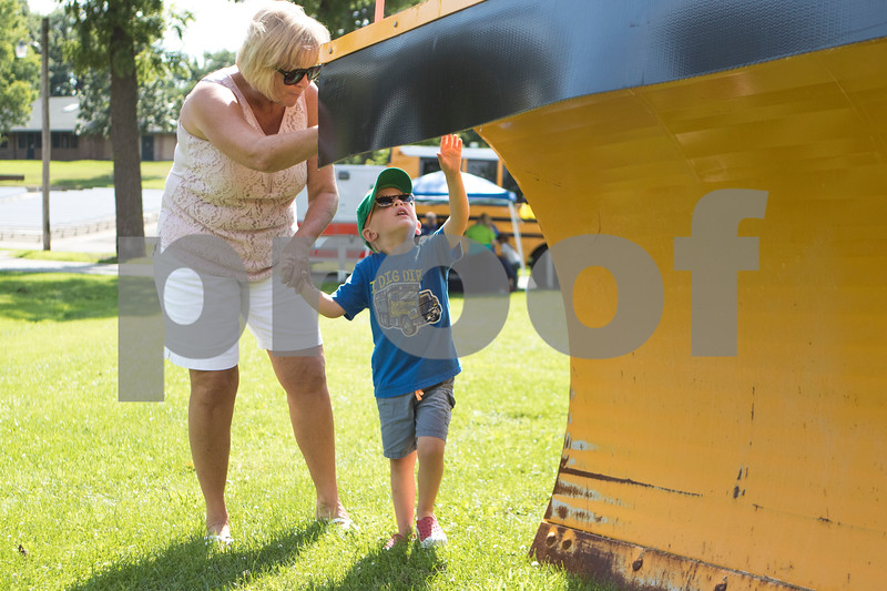 Sam Buckner for Shaw Media.<br /> James Davani, age 3, touches a plow on a road grader with his grandma Lori Phelps at Family Fun Fest on Tuesday July 25, 2017 at Hopkins Park.