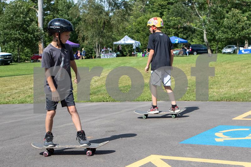 Sam Buckner for Shaw Media.<br /> Luke, 8, (left) and J.T. 11 Duffy practice skateboarding at the Fargo Skateboarding booth at Family Fun Fest on Tuesday July 25, 2017 at Hopkins Park.