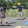 Sam Buckner for Shaw Media.<br /> Luke, 8, (left) and J.T. 11 Duffy practice skateboarding at the Fargo Skateboarding booth at Family Fun Fest on Tuesday July 25, 2017 at Hopkins Park.
