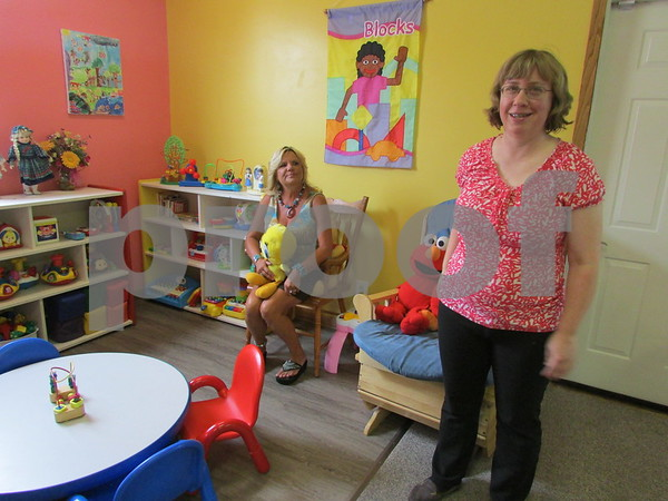 Audrey Herrmann (left), owner of Creative Kids Connection, 530 Charter St. in DeKalb, and the day care's director, Virginia Sanchez, give a tour of one of the 3- to 5-year-old areas at the new center.