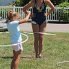 Ali Weibel of the Cincinnati Circus encourages Ava Schwartz, 7, of Montville, to come up and try out the hula hoops after with her after her circus  performance at the 2018 Lake County Fair on July 25.<br /> Kristi Garabrandt - The News-Herald