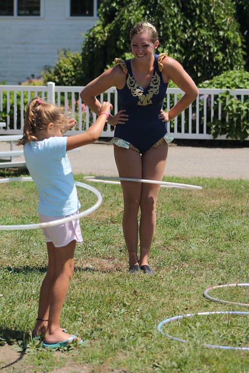 . Ali Weibel of the Cincinnati Circus encourages Ava Schwartz, 7, of Montville, to come up and try out the hula hoops after with her after her circus  performance at the 2018 Lake County Fair on July 25. Kristi Garabrandt - The News-Herald