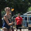 Ali Weibel of the Cincinnati Circus twirls a flaming baton at the 2018 Lake County Fair on July 25.<br /> Kristi Garabrandt - The News-Herald