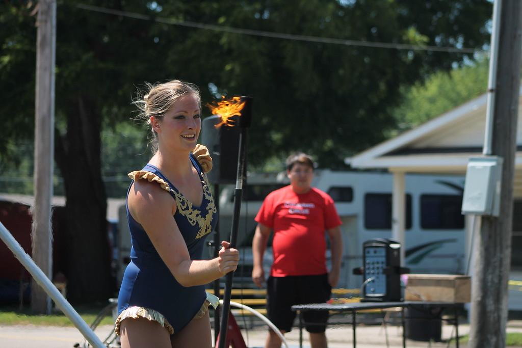 . Ali Weibel of the Cincinnati Circus twirls a flaming baton at the 2018 Lake County Fair on July 25. Kristi Garabrandt - The News-Herald