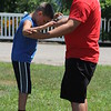Alban Schneider of the Cincinnati Circus helps  Mac Schwartz, 9, of Montville,get his balance on the balance board after his circus  performance at the 2018 Lake County Fair on July 25.<br /> Kristi Garabrandt - The News-Herald