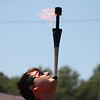 Alban Schneider of the Cincinnati Circus balances a fire wand on his chin at the beginning of his fire juggling act  during his July 25,  performance at the 2018 Lake County Fair.<br /> Kristi Garabrandt - The News-Herald